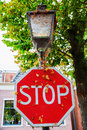 Stop sign with spider webs Royalty Free Stock Photo
