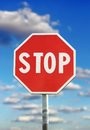 Stop sign traffic over blue cloudy sky background Stock Photography
