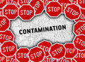Stop sign and word contamination Royalty Free Stock Photo