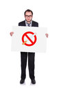 Stop smoking symbol businessman holding a placard with Royalty Free Stock Photo