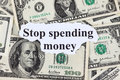 Stop spending money words and dollar bills close up Royalty Free Stock Photos