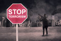 Stop Terrorism text with male terrorist Royalty Free Stock Photo