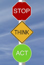 Stop think act modified colorful road signs with a safety message Royalty Free Stock Photo