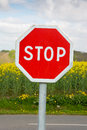 Stop traffic sign with grenola plants in the background upright nobody Stock Photography