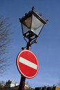 """""""stop"""" traffic sign on old fashioned street lamp in amsterdam the netherlands Stock Images"""