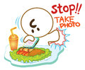 Stop he want take a photo food first time by mobile smart phone to eat his and share on social network very serious Royalty Free Stock Images
