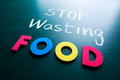 Stop wasting food concept colorful words on blackboard Stock Images