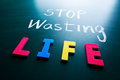 Stop wasting life concept colorful words on blackboard Royalty Free Stock Photos