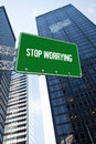Stop worrying against low angle view of skyscrapers the word and green billboard sign Royalty Free Stock Image
