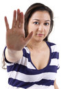 Stop young female with a gesture Royalty Free Stock Images