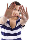Stop young female with a gesture Royalty Free Stock Photography