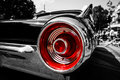 Stoplight of a personal luxury car ford thunderbird x third generation x berlin june close up combined toning black and white red Stock Photos
