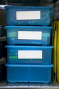 Storage bins clear blue plastic drawers with schoolar items Royalty Free Stock Images