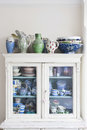 Storage cabinet with crockery displayed in at home Royalty Free Stock Image