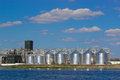 Storage of grain near the water Royalty Free Stock Photo