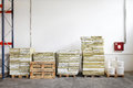 Storage pallets with construction material in room Royalty Free Stock Image