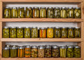 Storage shelves with canned food in pantry homemade preserved fruits and vegetables Royalty Free Stock Image