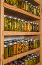 Storage shelves with canned food in pantry homemade preserved fruits and vegetables Stock Image