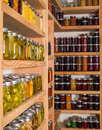 Storage shelves with canned food in pantry homemade preserved fruits and vegetables Royalty Free Stock Photos