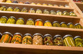 Storage shelves with canned food in pantry homemade preserved fruits and vegetables Stock Photos