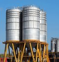 Storage silos for differents types of free flowing raw materials Royalty Free Stock Photo