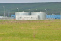 Storage tanks industrial water in the field Royalty Free Stock Photography