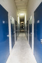 Storage units indoor self with blue doors Stock Photos