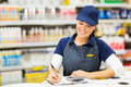 Store clerk writing stock beautiful in supermarket Stock Photo