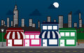 Store Fronts and Skyline Buildings at night Royalty Free Stock Photos