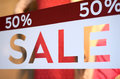 Store sale window display retail image of a sign in a clothing with shallow dof Stock Image