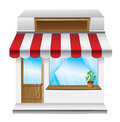 Store with stripe awning Royalty Free Stock Photography