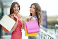 In store young attractive girls with shopping bags Royalty Free Stock Photography