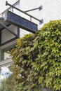 Storefront blank sign angled retail commercial space with boston ivy on exterior wall Stock Image