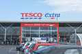 Storefront and carpark to a tesco extra in gillingham kent in the uk tesco is a british multinational grocery and is the third Stock Photo