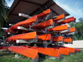 Storing canoes on racks in open shed Stock Photography