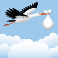 Stork flying with baby in sky Royalty Free Stock Photo
