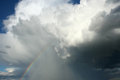 Storm cloud rainbow Stock Image
