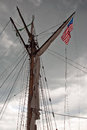 Storm clouds above the tallship us flag is on a mast of sailing ship Royalty Free Stock Image