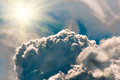 Storm Clouds in the blue sky and sun, background