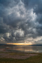 Storm clouds gather over lake a in sardinia italy Stock Image