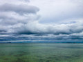 Storm clouds gathering over tropical ocean waters Royalty Free Stock Image