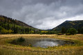 Storm clouds over lockett meadow near flagstaff arizona gather the san francisco peaks as seen from Royalty Free Stock Photo