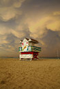 Storm clouds over miami beach florida colorful lifeguard house in a typical art deco architecture at sunset with ocean and sky Royalty Free Stock Photo