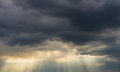 Storm clouds and sunrays Royalty Free Stock Photo