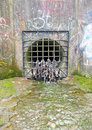 Storm drain with garbage encrusted grate Royalty Free Stock Photo