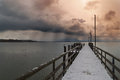 Storm on herrenchiemsee a footbridge at the lake with approaching Royalty Free Stock Photo