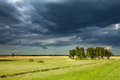 Before the storm landscape with green field and clouds Stock Image