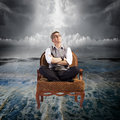 Storm man sitting on armchair in the ocean water danger concept Royalty Free Stock Photography