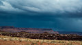 Storm over the desert in canyonlands national park spring moving through maze district of utah as seen from candlestick campsite Royalty Free Stock Image