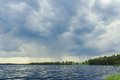 Storm sky on forest lake before rain Royalty Free Stock Photo